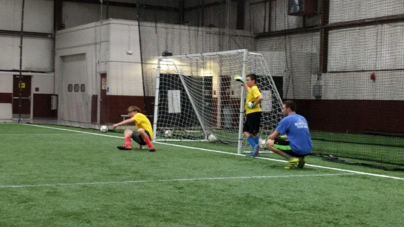 Coach Austin working with goalkeeper footwork.