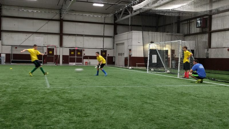 Coach Austin working with keepers on positioning.